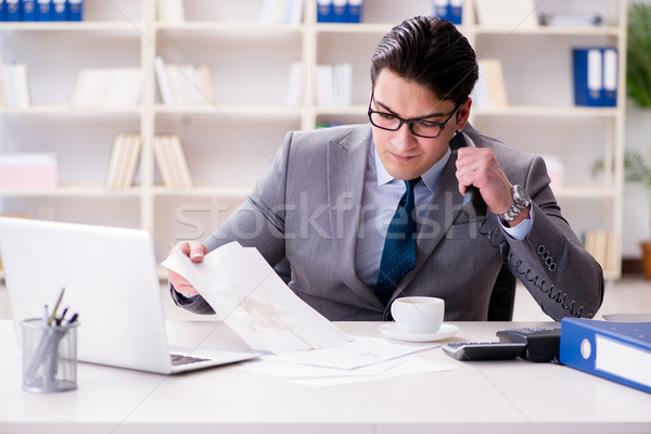 The businessman spilling coffee on important documents Stock photo © Elnur