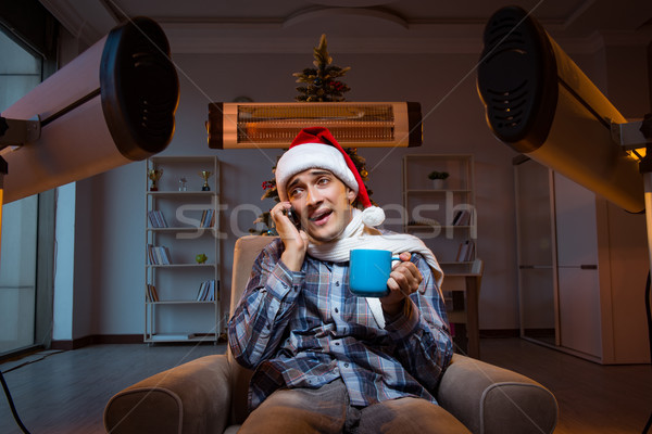 Man suffering from cold at home Stock photo © Elnur