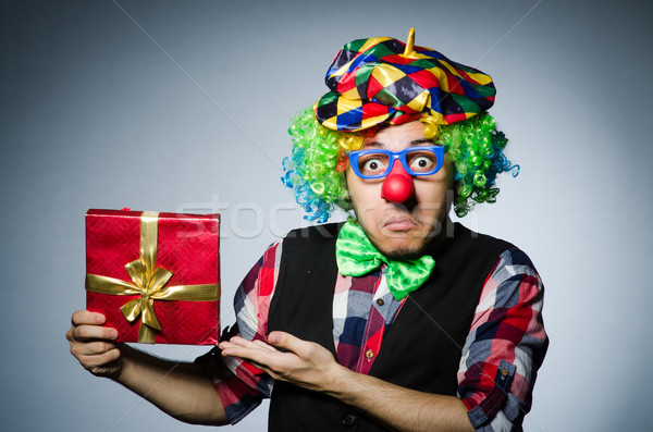 Funny clown with red giftbox Stock photo © Elnur