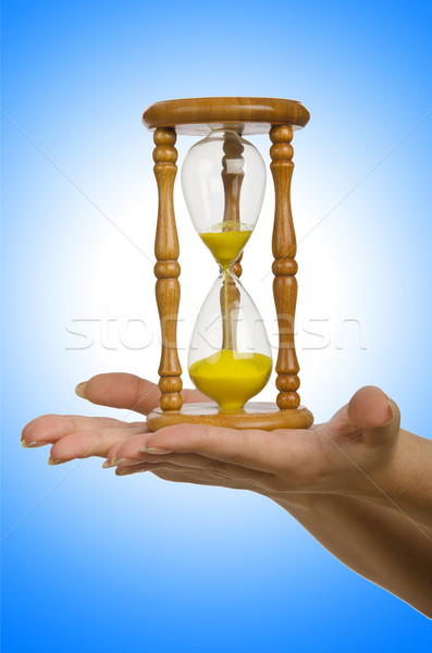 Hand holding hourglass on white Stock photo © Elnur