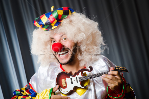 Angry clown with guitar in funny concept Stock photo © Elnur