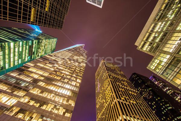 Híres felhőkarcolók New York éjszaka üzlet égbolt Stock fotó © Elnur