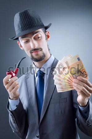 Empresário criminal dinheiro homem fundo preto Foto stock © Elnur