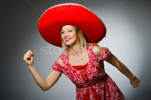 Donna indossare nice rosso sombrero dancing Foto d'archivio © Elnur