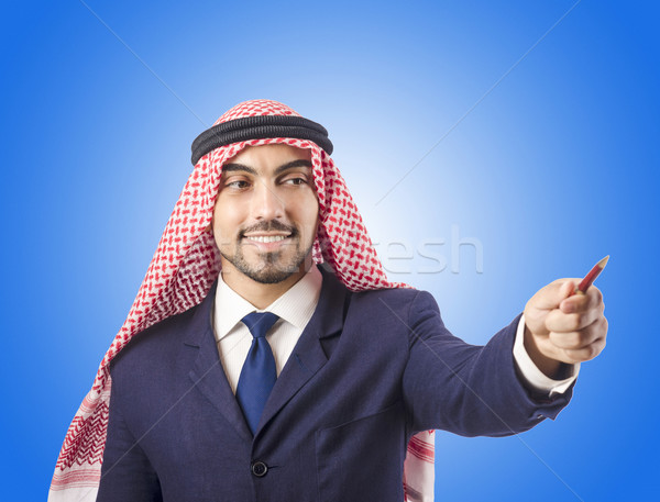 Arab man pressing virtual buttons Stock photo © Elnur