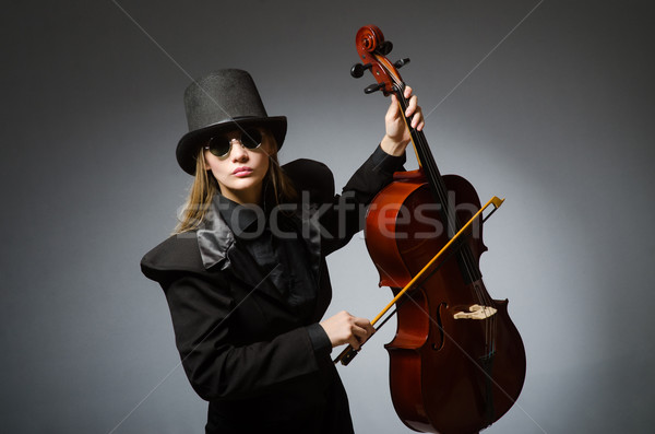 Woman playing classical cello in music concept Stock photo © Elnur