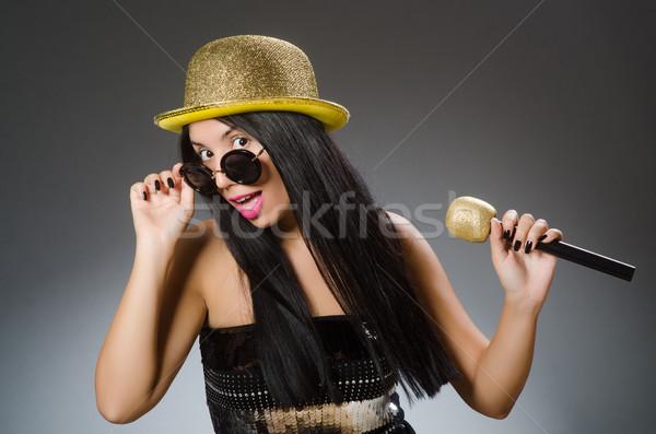 Young woman singing in karaoke club Stock photo © Elnur