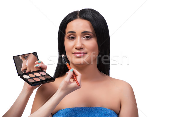Stock photo: Young woman getting make-up isolated on white