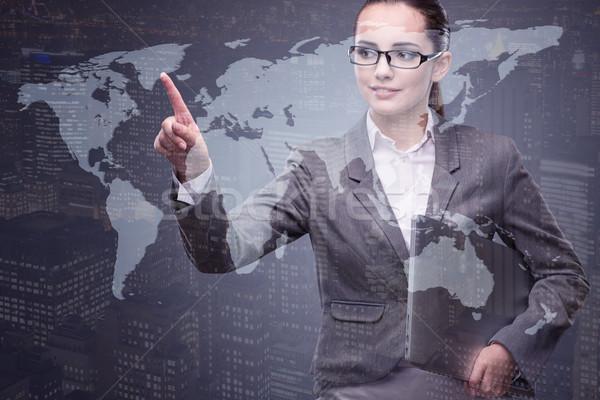 Stockfoto: Zakenvrouw · laptop · wereldwijde · business · computer · wereld · aarde