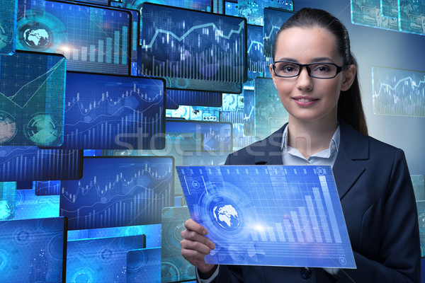 Businesswoman in online stock trading business concept Stock photo © Elnur