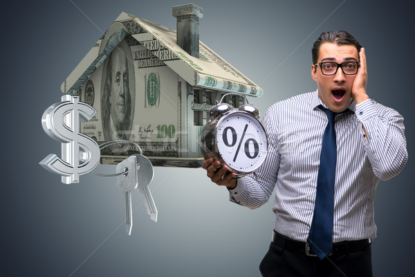 Young businessman surprised at high interest mortgage rates Stock photo © Elnur