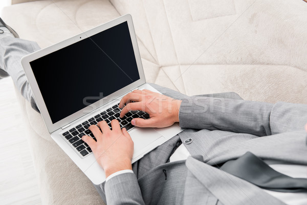 Businessman working with laptop in business concept Stock photo © Elnur