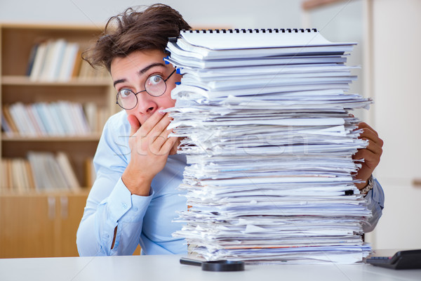 Mad businessman with piles of papers Stock photo © Elnur