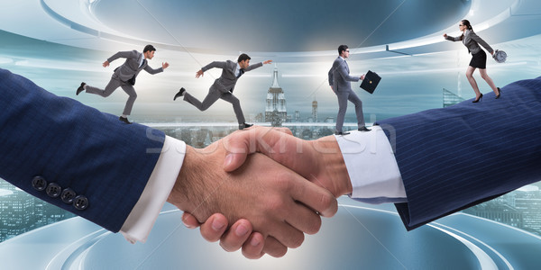 Cooperation concept with people running on handshake Stock photo © Elnur