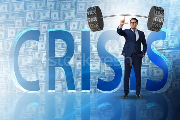 Businessman under  heavy burden of taxes Stock photo © Elnur
