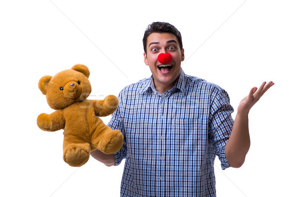 Funny clown man with a soft teddy bear toy isolated on white bac Stock photo © Elnur