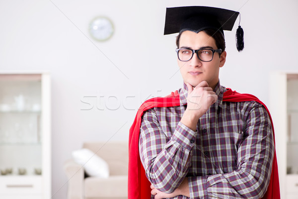 Super hero student wearing mortarboard in a red cloak Stock photo © Elnur