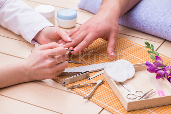 Hand manicure concept for man Stock photo © Elnur