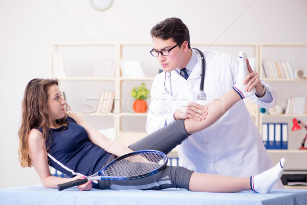 Man doctor taking care of sports injury Stock photo © Elnur
