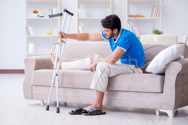 Injured young man recovering at home Stock photo © Elnur