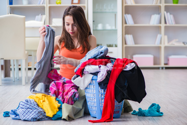Stressed woman doing laundry at home Stock photo © Elnur