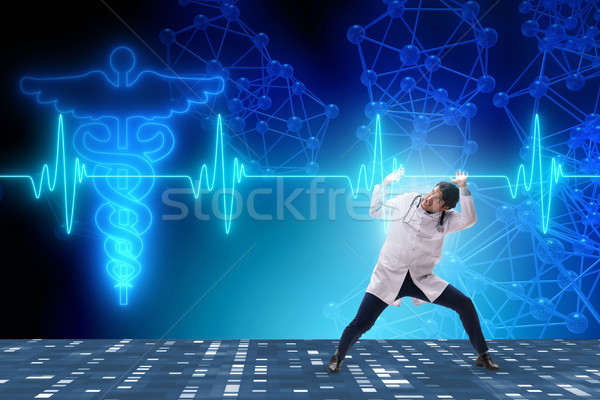 Doctor cardiologist supporting cardiogram heart line Stock photo © Elnur