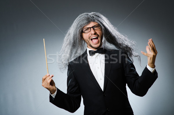 Funny conductor with long grey hair Stock photo © Elnur