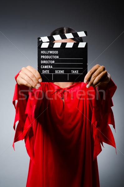 Uomo vestito rosso film sorriso sfondo rosso Foto d'archivio © Elnur