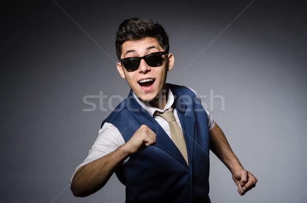 Fiatalember kék mellény szürke férfi háttér Stock fotó © Elnur