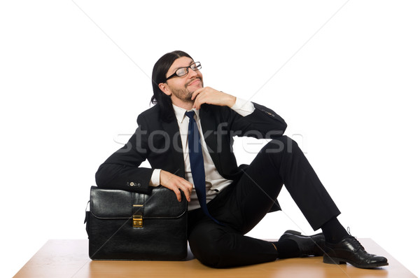 Young businessman sitting on the floor isolated on white Stock photo © Elnur