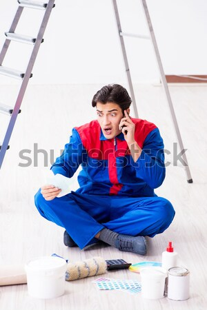 The funny repairman with tools isolated on white Stock photo © Elnur