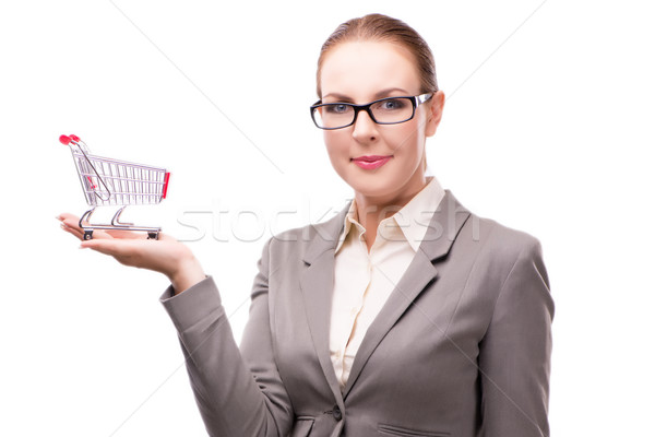 Businesswoman with shopping cart trolley isolated on white Stock photo © Elnur