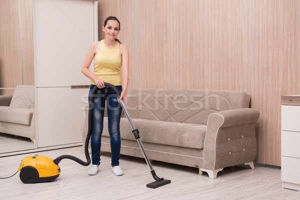 The young woman doing cleaning at home Stock photo © Elnur