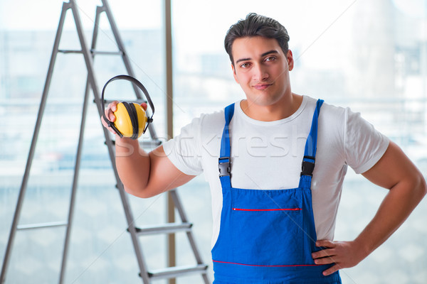 Worker with noise cancelling headphones Stock photo © Elnur