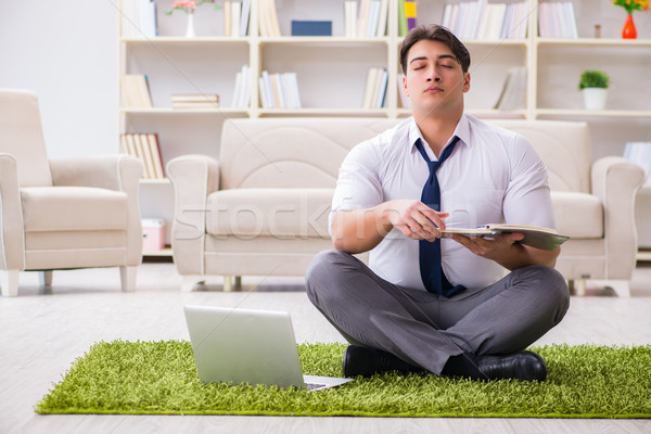 Businessman sitting on the floor in office Stock photo © Elnur