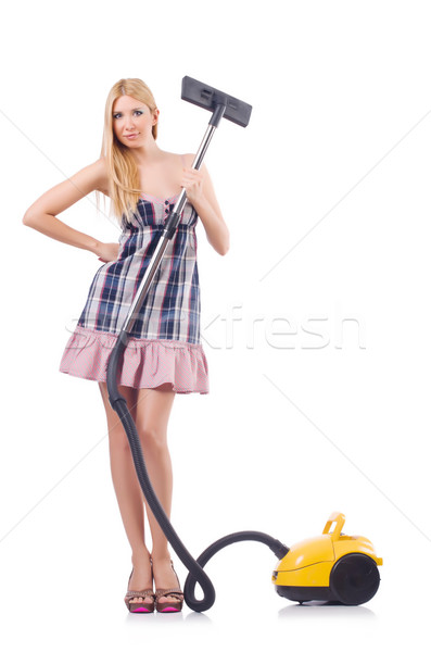 Stock photo: Young woman with vacuum cleaner on white