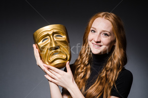 Redhead woman iwith mask in hypocrisy consept against grey backg Stock photo © Elnur