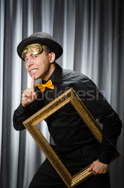 Stock photo: Funny concept with theatrical mask