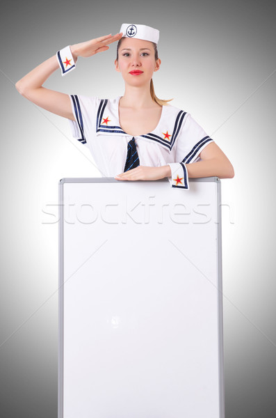 Stewardess with blank board on white Stock photo © Elnur