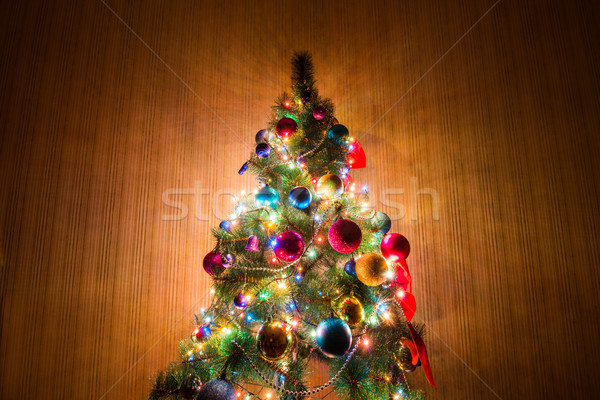 Christmas tree in dark room Stock photo © Elnur