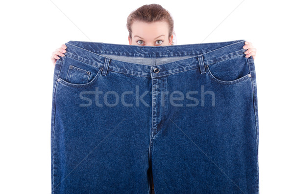 Woman with oversized jeans in dieting concept Stock photo © Elnur