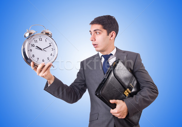 Businessman with clock isolated on white Stock photo © Elnur