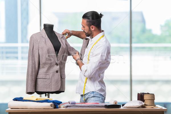 Genç terzi çalışma yeni giyim dizayn Stok fotoğraf © Elnur