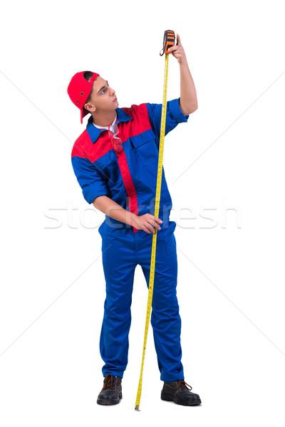 Genç şerit metre yalıtılmış beyaz adam Stok fotoğraf © Elnur