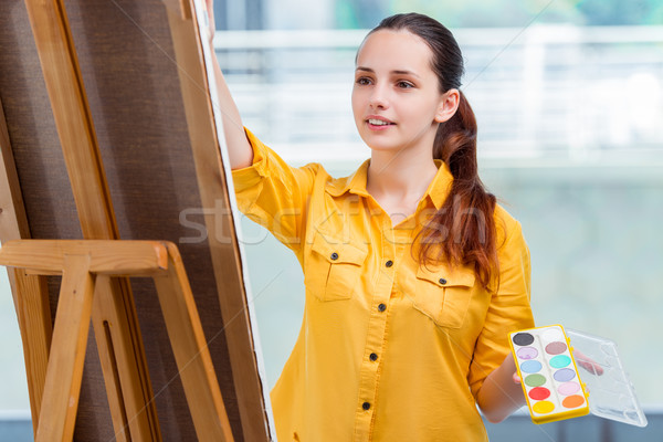 Young student artist drawing pictures in studio Stock photo © Elnur