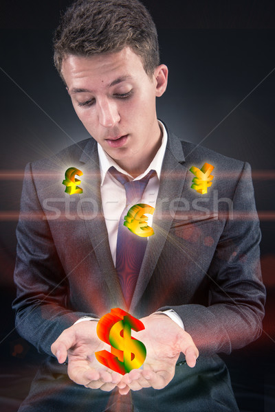 Businessman with various currencies in business concept Stock photo © Elnur