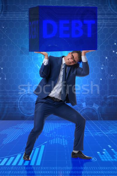 Businessman in debt business concept Stock photo © Elnur