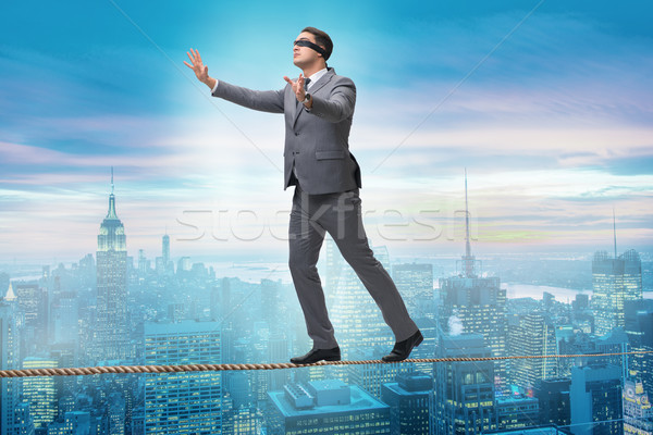 The man walking in tight rope blindfold Stock photo © Elnur