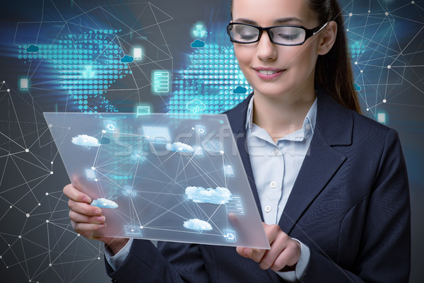 Woman with tablet in cloud computing concept Stock photo © Elnur