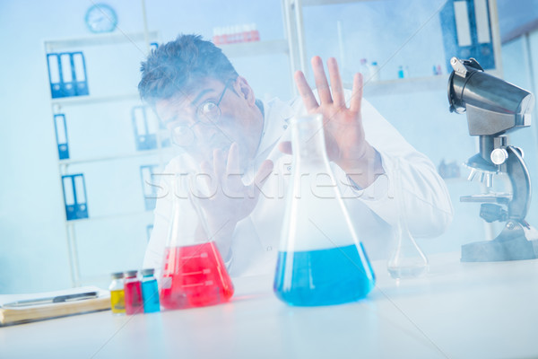 Funny mad chemist working in a laboratory Stock photo © Elnur